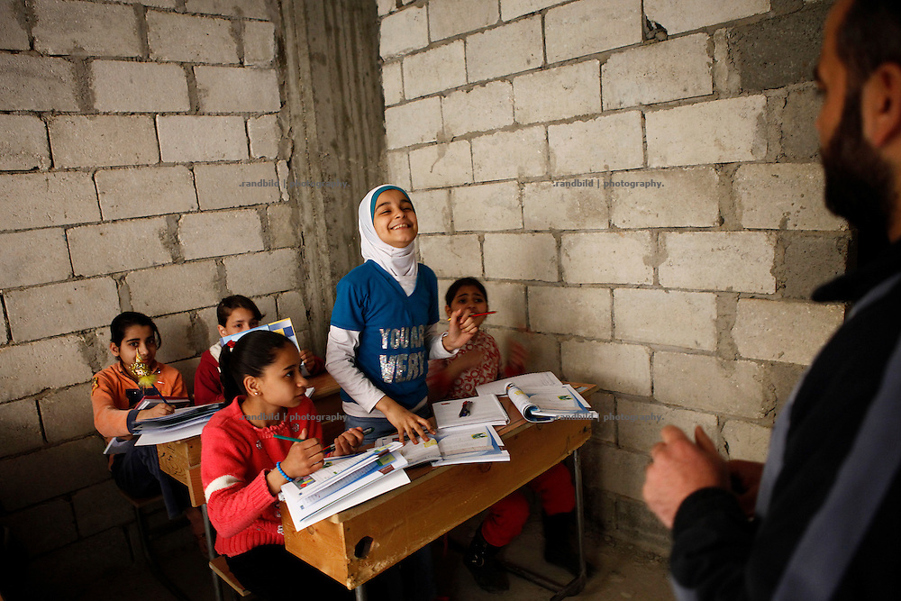 In a western neighbourhood of deir az-Zor volunteers run a underground school to teach children lessons missed during heavy battles in town where school have been targeted by shelling. Residents of eastern syrian town Deir az-Zor joined arab spring protests against the regime of Bashar al-Assad from its early beginning in March 2011. Since summer 2012 the town with few hundred thousand inhabitants is embattled between the Syrian Army and different opposing rebel groups like Free Syrian Army and Jabhat al-Nusra. Deir az-Zor is target to constant shelling by artillery, war planes and short range missiles. Almost 70 percent of the town is rebel held while government forces remain in control over some residental areas and a strategic important airport. Deir az-Zor is widely damaged and some areas almost totally destroyed by fierce and long lasting battles. All direct road connections to Deir az-Zor are cut and fighters and returning residents as well depend on one provisional supply line across the Euphrates river which is regularly targeted by government snipers.