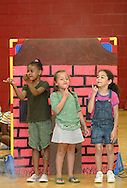 Middletown, NY - Three girls from YMCA summer camp perform in a play for their parents in the gymnasium on July 20, 2007..