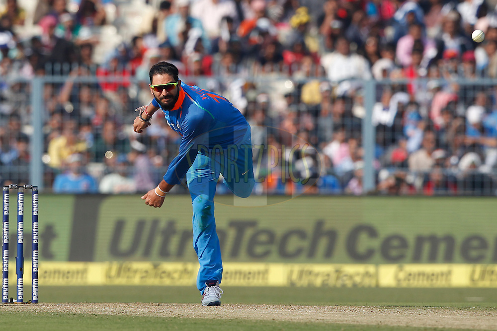 Yuvraj Singh of India bowls a delivery during the third One Day International (ODI) between India and England  held at Eden Gardens in Kolkata on the 22nd January 2017<br /> <br /> Photo by: Deepak Malik/ BCCI/ SPORTZPICS