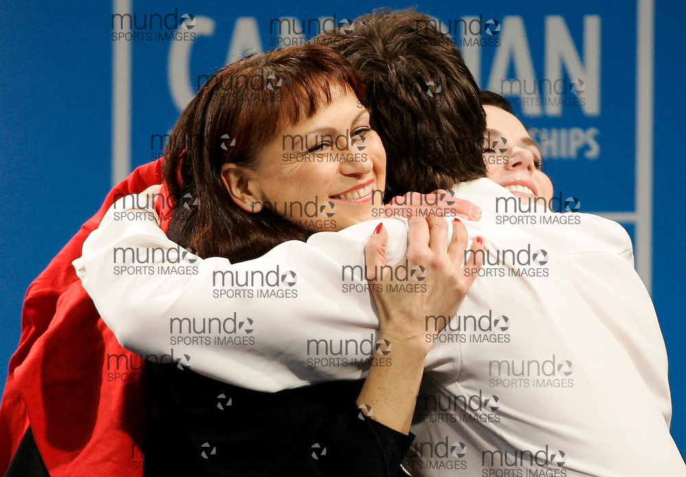 London, Ontario ---10-01-16---  Scott Moir gets a hug from his partner Tessa Virtue, right, and their coach Marina Zoueva after winning the dance competition at the 2010 BMO Canadian Figure Skating Championships in London, Ontario, January 16, 2010. Virtue and Moir won the event, securing a spot on the Olympic team headed to Vancouver in February..GEOFF ROBINS/Mundo Sport Images..