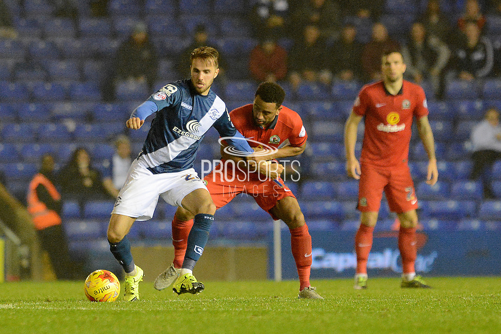 Blackburn Rovers midfielder Lee Williamson holds up Birmingham City midfielder Andrew Shinnie during the Sky Bet Championship match between Birmingham City and Blackburn Rovers at St Andrews, Birmingham, England on 3 November 2015. Photo by Alan Franklin.