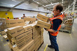 "© London News Pictures. File pic dated. 13/12/2012. Swansea, UK. A BBC investigation into a UK-based Amazon warehouse has found conditions that a stress expert said could cause ""mental and physical illness"". PICTURED - Staff at the Amazon Swansea fulfilment centre process orders as they prepare their busiest time of the year. The 800,000 sq ft fulfilment centre, the largest of Amazon's plants in England and Whales, is big enough to hold 10 football pitches. Over 1,000 extra jobs are created at the centre to cope with the extra seasonal workload. Photo credit: Ben Cawthra/LNP"