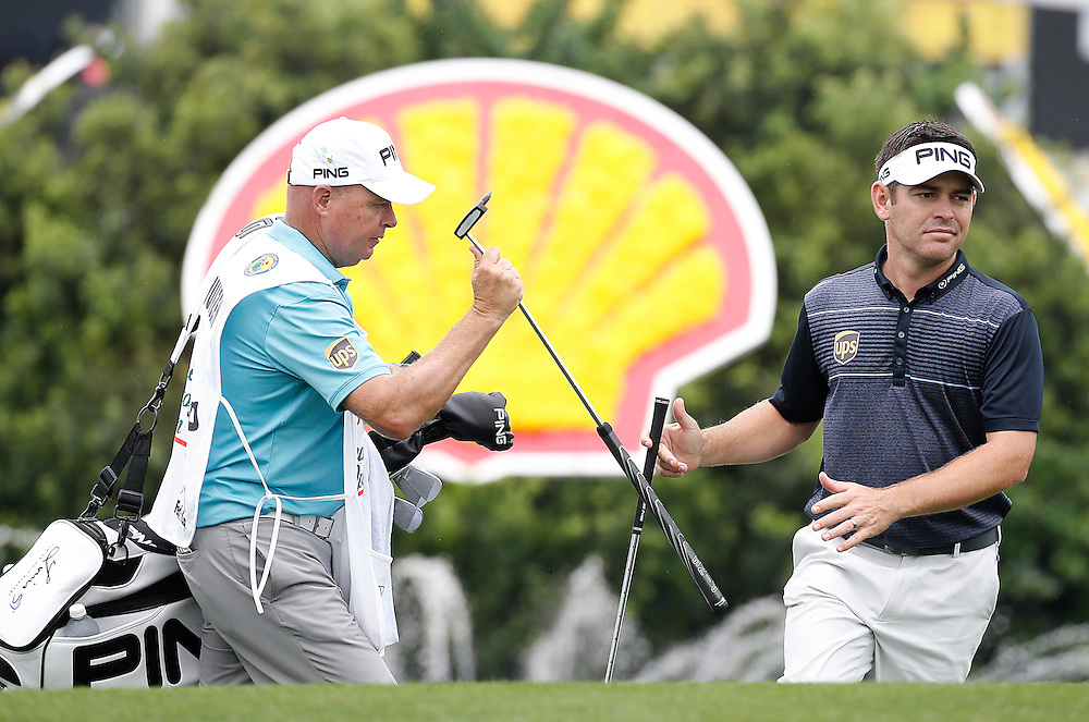 Louis Oosthuizen gives his wedge to his caddie on hole 18 in the Shell Houston Open-Round 1 at the Golf Club of Houston on Wednesday, March 31, 2016 in Humble, TX. (Photo: Thomas B. Shea/For the Chronicle)