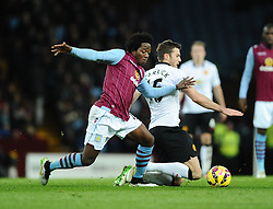 Manchester United's Michael Carrick is fouled by Aston Villa's Carlos Sanchez  - Photo mandatory by-line: Joe Meredith/JMP - Mobile: 07966 386802 - 20/12/2014 - SPORT - football - Birmingham - Villa Park - Aston Villa v Manchester United - Barclays Premier League