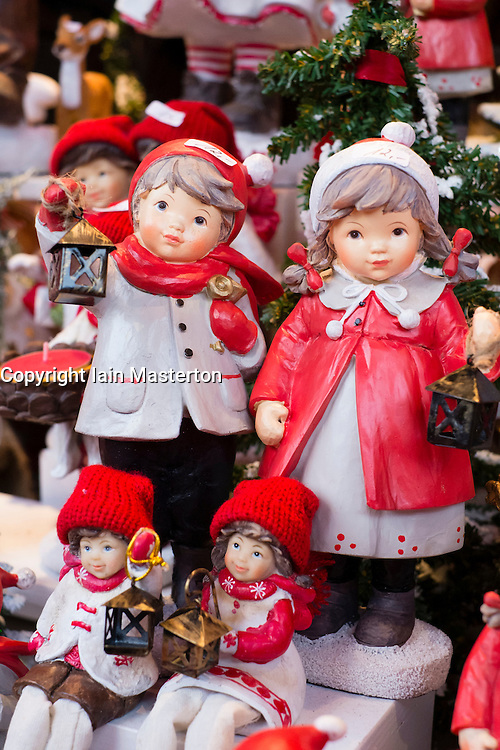 Traditional Christmas carved wooden ornaments for sale on stall at Christmas market in Cologne Germany