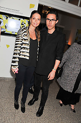 EDWARD TANG and NATALIA BLASKOVICOVA at the Swarovski Whitechapel Gallery Art Plus Fashion fundraising gala in support of the gallery's education fund held at The Whitechapel Gallery, 77-82 Whitechapel High Street, London E1 on 14th March 2013