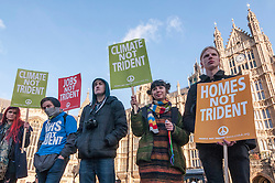 © Licensed to London News Pictures. 24/01/2015. Westminster, UK. Demonstrators outside the Houses of Parliament as they stage a mass protest against government plans to spend £100 billion replacing Trident, the UK's Cold War nuclear weapons system.  They encircled government and parliament buildings with a peace scarf knitted by thousands of people. Photo credit : Stephen Chung/LNP