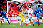 Peterborough Utd goalkeeper Conor O'Malley (25) denies Doncaster Rovers forward Mallik Wilks (7) during the EFL Sky Bet League 1 match between Doncaster Rovers and Peterborough United at the Keepmoat Stadium, Doncaster, England on 9 February 2019.