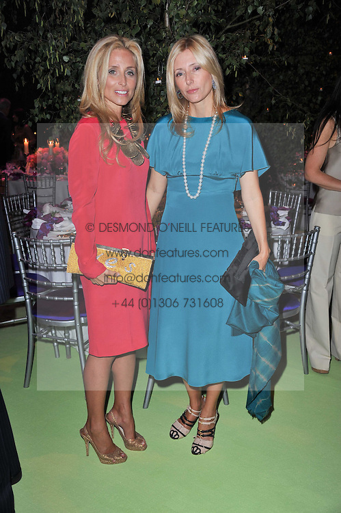 Left to right, sisters PIA GETTY and PRINCESS MARIE CHANTAL OF GREECE at a dinner hosted by Cartier in celebration of the Chelsea Flower Show held at Battersea Power Station, 188 Kirtling Street, London SW8 on 23rd May 2011.