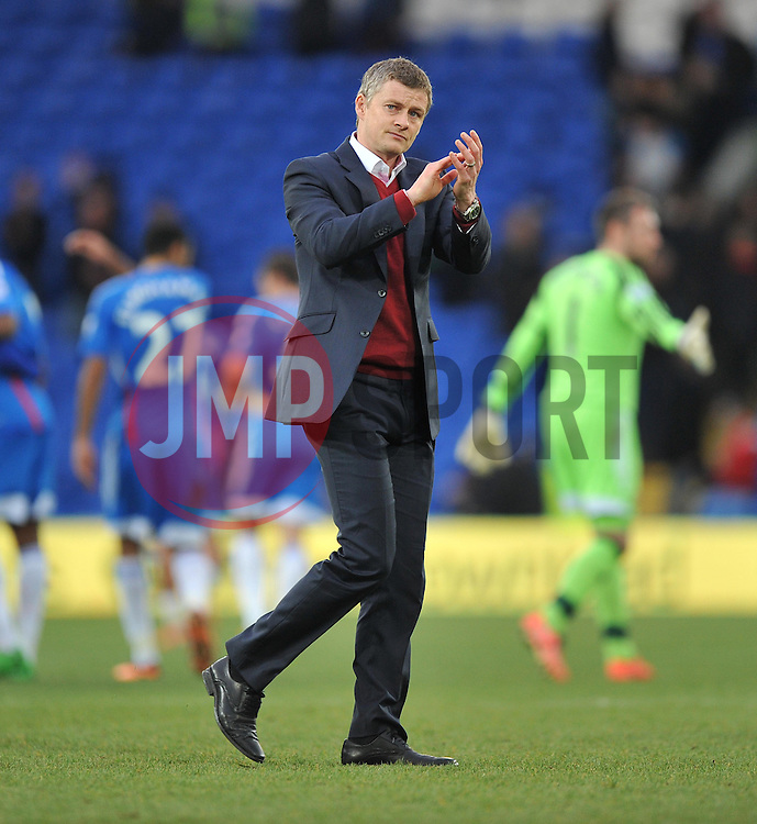 Cardiff City Manager, Ole Gunnar Solskjær claps the home fans. - Photo mandatory by-line: Alex James/JMP - Tel: Mobile: 07966 386802 22/02/2014 - SPORT - FOOTBALL - Cardiff - Cardiff City Stadium - Cardiff City v Hull City - Barclays Premier League