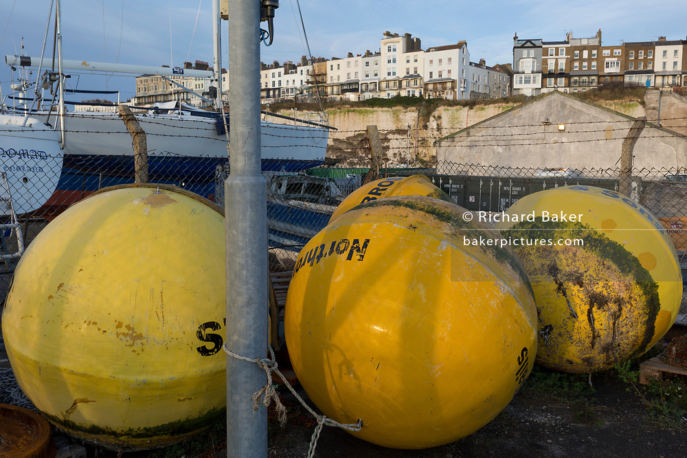 Giant shipping buoys in Ramsgate Harbour, on 8th January 2019, in Ramsgate, Kent, England. The Port of Ramsgate has been identified as a 'Brexit Port' by the government of Prime Minister Theresa May, currently negotiating the UK's exit from the EU. Britain's Department of Transport has awarded to an unproven shipping company, Seaborne Freight, to provide run roll-on roll-off ferry services to the road haulage industry between Ostend and the Kent port - in the event of more likely No Deal Brexit. In the EU referendum of 2016, people in Kent voted strongly in favour of leaving the European Union with 59% voting to leave and 41% to remain.