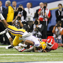 Dec 3, 2011; Atlanta, GA, USA; LSU Tigers quarterback Jordan Jefferson (9) is tackled by Georgia Bulldogs linebacker Cornelius Washington (83) during the second half of the 2011 SEC championship game at the Georgia Dome.  Mandatory Credit: Derick E. Hingle-US PRESSWIRE