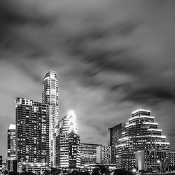 Austin skyline at night black and white vertical photo. Austin Texas is a major city in the Southwestern United States of America. Photo was taken in 2016.