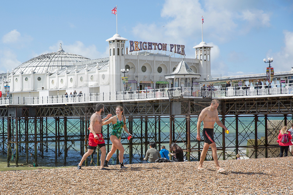 © Licensed to London News Pictures. 20/05/2017. Brighton, UK. Members of the Brighton Swimming Club brave the still colder seawater to go for a swim as sunny weather is hitting the seaside resort. Photo credit: Hugo Michiels/LNP