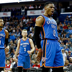 Jan 25, 2017; New Orleans, LA, USA; Oklahoma City Thunder guard Russell Westbrook (0) reacts after teammate center Enes Kanter (not pictured) during against the New Orleans Pelicans during the first quarter of a game at the Smoothie King Center. Mandatory Credit: Derick E. Hingle-USA TODAY Sports