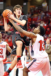 08 November 2015: Matt Hein(5) goes to the hoop guarded by Terrence Tisdell(13). Illinois State Redbirds host the Southern Indiana Screaming Eagles and beat them 88-81 in an exhibition game at Redbird Arena in Normal Illinois (Photo by Alan Look)