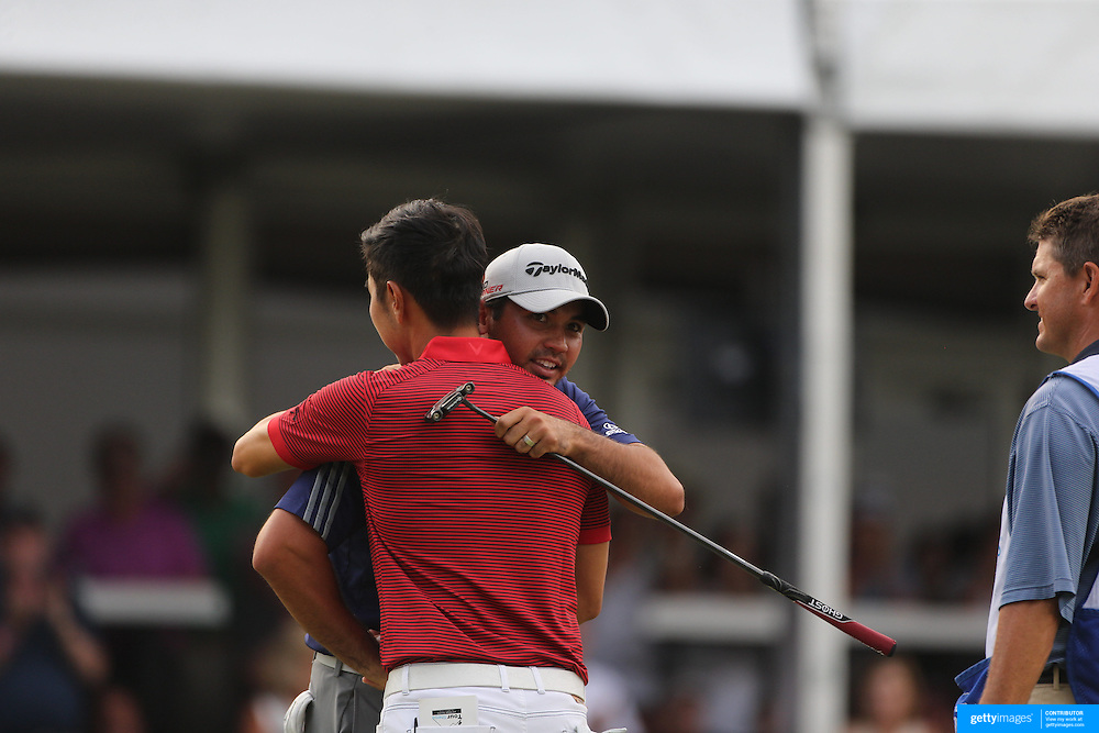 Jason Day, Australia, is congratulated by Sangmoon Bae, South Korea,  on the final hole after winning the The Barclays Golf Tournament by six shots at The Plainfield Country Club, Edison, New Jersey, USA. 30th August 2015. Photo Tim Clayton