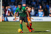 Coventry City defender Jordan Willis (4) goes past Luton Town forward James Collins during the EFL Sky Bet League 1 match between Luton Town and Coventry City at Kenilworth Road, Luton, England on 24 February 2019.