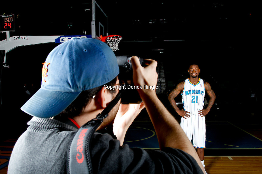 December 14, 2011; New Orleans, LA, USA; Photographer Jonathan Bachman shoots a portrait of New Orleans Hornets guard Terrico White (21) during Media Day at the New Orleans Arena.   Mandatory Credit: Derick E. Hingle-US PRESSWIRE