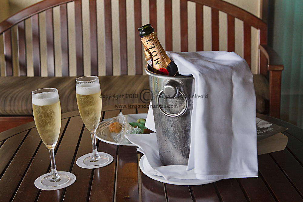 A bucket with Moët et Chandon champagne and two filled glasses