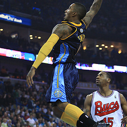 28 January 2009:  Denver Nuggets guard J.R. Smith (1) attempts a dunk during a 94-81 win by the New Orleans Hornets over the Denver Nuggets at the New Orleans Arena in New Orleans, LA. The Hornets wore special throwback uniforms of the former ABA franchise the New Orleans Buccaneers for the game as they honored the Bucs franchise as a part of the NBA's Hardwood Classics series. .