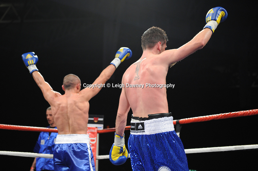 Both Darren Barker (right) and Domenico Spada ready to claim the title before the referees final decision at London's Olympia on Saturday 30th April 2011 for the European Middleweight Championship. Matchroom Sport. Photo credit © Leigh Dawney.