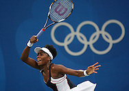 BEIJING, CHINA:  USA's Venus Williams returns a ball hit by Victoria Azarenka at the 2008 Olympics in Beijing, China  on Wednesday,8/13/08 in Beijing, China.  ©2008 Johnny Crawford