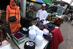 "June 15, 2018 - Philippines - A ""tutob"" selling outside the Golden Mosque during the celebration of Eidul Fitr in Manila City on June 15, 2015. Eidul Fitr is an important celebration for Filipino Muslims, marking the end of the month-long fast during Ramadan. In 2018, Eidul Fitr falls on Friday 15 June. (Credit Image: © Gregorio B. Dantes Jr/Pacific Press via ZUMA Wire)"