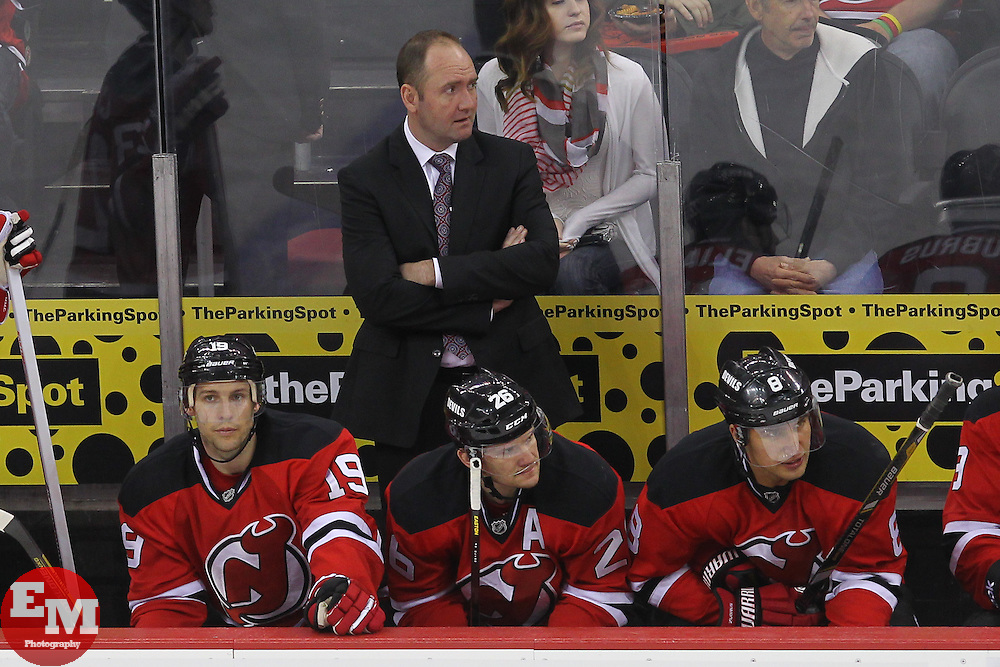 Apr 23, 2013; Newark, NJ, USA; New Jersey Devils head coach Peter DeBoer watches the action during the third period at the Prudential Center. The Devils defeated the Canadiens 3-2.