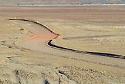 Winding desert road in the Australian Outback near Coober Pedy, Australia.