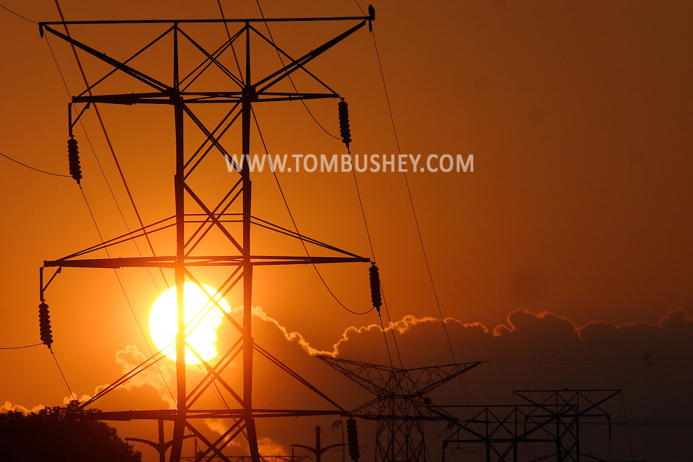 Wawayanda, N.Y. - The sun sets behnd power lines in the Town of Wawayanda, N.Y., on May 29, 2006. ©Tom Bushey