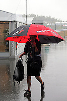 An F1 umbrella in a wet and rainy paddock.<br /> Japanese Grand Prix, Thursday 2nd October 2014. Suzuka, Japan.