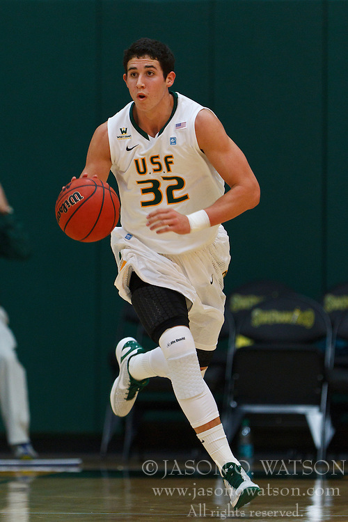 Nov 16, 2011; San Francisco CA, USA;  San Francisco Dons forward Angelo Caloiaro (32) dribbles the ball up court against the San Jose State Spartans during the first half at War Memorial Gym.  San Francisco defeated San Jose State 83-81 in overtime. Mandatory Credit: Jason O. Watson-US PRESSWIRE