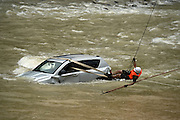 CHONGQING, CHINA - JULY 14: (CHINA OUT) <br /> <br /> fireman transfers a car trapped into flood<br /> <br /> A fireman transfers a car trapped into flood with the help of crane at Wuxi County on July 14, 2015 in Chongqing, China. Heavy rain fell in Chongqing Tuesday night which resulted in torrential flood and damage to local resident and vehicles. <br /> ©Exclusivepix Media