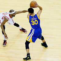 25 May 2015: Houston Rockets guard Corey Brewer (33) defends on Golden State Warriors guard Stephen Curry (30) during the Houston Rockets 128-115 victory over the Golden State Warriors, in game 4 of the Western Conference finals, at the Toyota Center, Houston, Texas, USA.