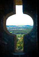 A view of the landscape through a hole in a turret at Chateauneuf-en-Auxois.