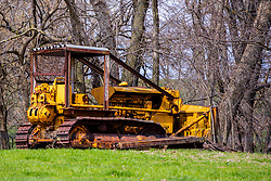An apparently decommissioned bull dozer sits on the site where Moores Mill once stood west of McLean Il