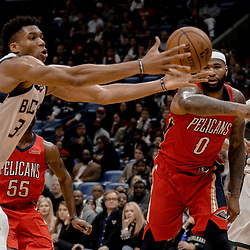Dec 13, 2017; New Orleans, LA, USA; New Orleans Pelicans center DeMarcus Cousins (0) defends against Milwaukee Bucks forward Giannis Antetokounmpo (34) during the fourth quarter at the Smoothie King Center. The Pelicans defeated the Bucks 115-108. Mandatory Credit: Derick E. Hingle-USA TODAY Sports
