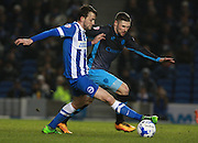 Brighton central midfielder Dale Stephens gets the better of Sheffield Wednesday striker Gary Hooper during the Sky Bet Championship match between Brighton and Hove Albion and Sheffield Wednesday at the American Express Community Stadium, Brighton and Hove, England on 8 March 2016. Photo by Bennett Dean.
