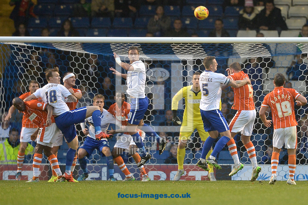 Lee Erwin of Bury (3rd left) heads at goal during the Sky Bet League 1 match at Gigg Lane, Bury<br /> Picture by Ian Wadkins/Focus Images Ltd +44 7877 568959<br /> 31/10/2015
