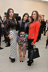 Left to right, SOURAYA CHALHOUB, LAURA COHEN and NATACHA TANNOUS at the launch of a new exhibition 'Le Tarbouche' by French-Lebanese artist Mouna Rebeiz held at The Saatchi Gallery, Duke of York's HQ, King's Road, London on 26th February 2015.