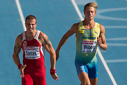 Igor Sarcevic of Serbia and Nicklas Wiberg of Sweden compete in heat 1 during the men's decathlon 100m at the 2010 European Athletics Championships at the Olympic Stadium in Barcelona on July 28, 2010. (Photo by Vid Ponikvar / Sportida)