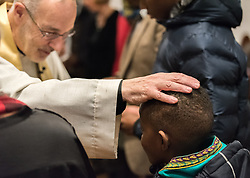 24 November 2019, Geneva, Switzerland: Rev. Michael Rusk blesses one of the parish's children during Sunday service at the Emmanuel Episcopal Church, Geneva.