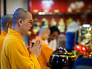 "22 AUGUST 2017 - BANGKOK, THAILAND: Mahayana Buddhist monks lead a ceremony on the first day of Hungry Ghost Month at the Poh Teck Tung Shrine in Bangkok's Chinatown. The seventh lunar month (August - September) is when many Chinese believe Hell's gate will open to allow spirits to roam freely in the human world. Many households and temples hold prayer ceremonies throughout the month-long Hungry Ghost Festival (Phor Thor) to appease the spirits. During the festival, believers will also worship the Tai Su Yeah (King of Hades) in the form of paper effigies which will be ""sent back"" to hell after the effigies are burnt.      PHOTO BY JACK KURTZ"