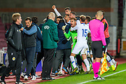 Dimitrios Nikolaou (#4) of Greece U21 is mobbed by his team mates after scoring a penalty goal during the U21 UEFA EUROPEAN CHAMPIONSHIPS match between U21 Scotland and U21 Greece at Tynecastle Park, Edinburgh, Scotland on 15 November 2019.