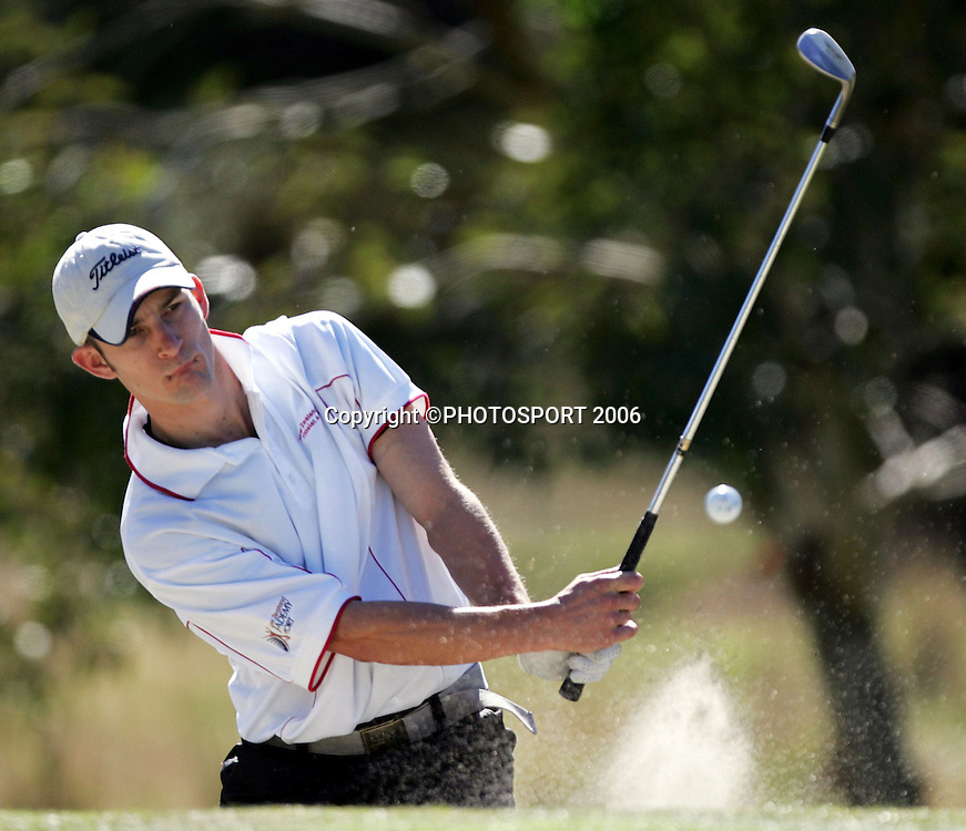 Hamilton's James Gill plays out of a bunker during his match against Australia's Mitchell Brown in the 2006 New Zealand Mens Golf Amateur Championship at Coringa Golf Course, Christchurch, on Saturday 8 April 2006. Brown won the match. Photo: Tim Hales/PHOTOSPORT