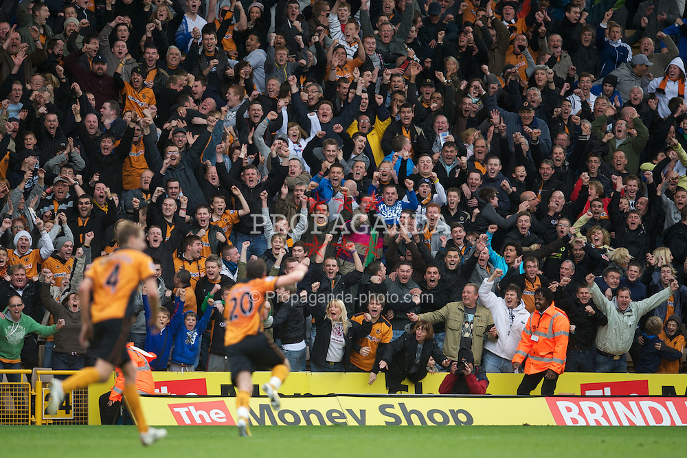 WOLVERHAMPTON, ENGLAND - Saturday, October 30, 2010: Wolverhampton Wanderers' supporters celebrate after Nenad Milijas scores the first equalising goal against Manchester City during the Premiership match at Molineux. (Pic by: David Rawcliffe/Propaganda)