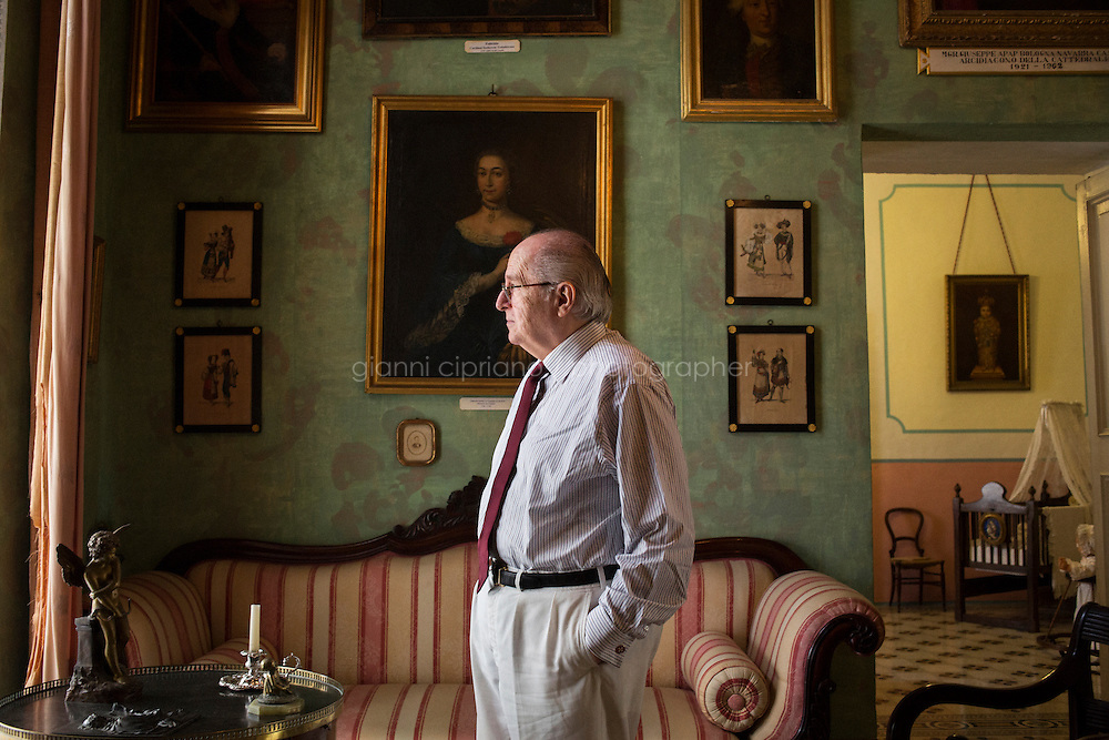 VALLETTA, MALTA - 2 November 2013: Marquis Nicholas de Piro (72), a Knight Hospitaller of the Order of St. John of Jerusalem (also known as Knights of Malta), is here in the Green Room of Casa Rocca Piccola, a 16th-century palace and home of the noble de Piro family in Valletta, Malta, on November 2nd 2013. <br /> <br /> Casa Rocca Piccola was one of two houses built in Valletta by Admiral Don Pietro la Rocca. It is referenced in maps of the time as &quot;la casa con giardino&quot; meaning, the house with the garden, as normally houses in Valletta were not allowed gardens.<br /> <br /> Valleta was named after Jean Parisot de Valette of the Order of St. John of Jerusalem, who succeeded in defending the island from an Ottoman invasion in 1565, known as the Siege of Malta. The city was founded immediately after the end of the Siege of Malta to fortify the Order's position in Malta and bind the Knights to the island.