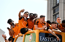 The Wolverhampton Wanderers players celebrate as their open top bus makes its way round during the winner's parade through Wolverhampton.