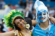 An Argentinian and a Brazilian fan before the 2014 FIFA World Cup match at Arena Corinthians, Sao Paulo<br /> Picture by Andrew Tobin/Focus Images Ltd +44 7710 761829<br /> 09/07/2014